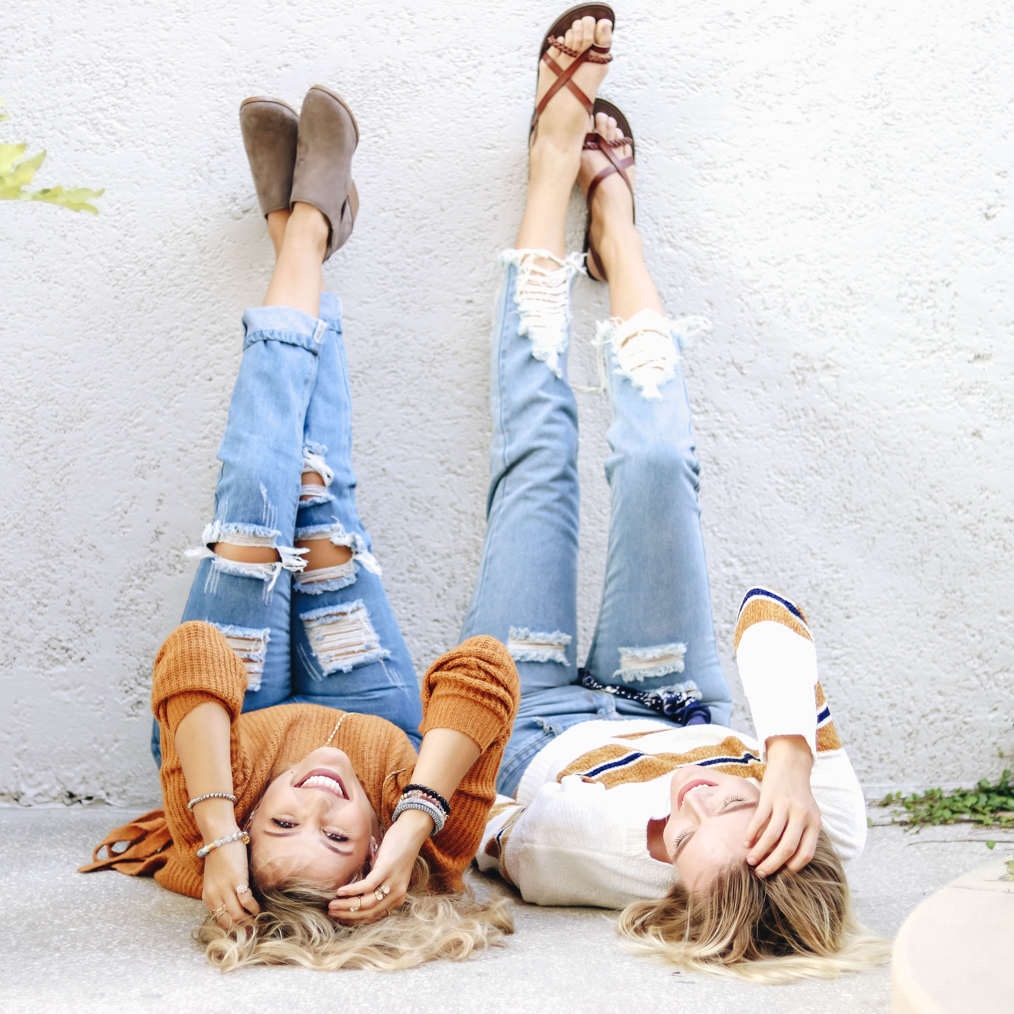this photo features a model wearing our Boutique Jeans distressed tears