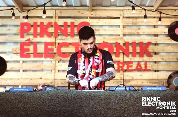 DJ Santi performing at Piknic Électronik 2018
