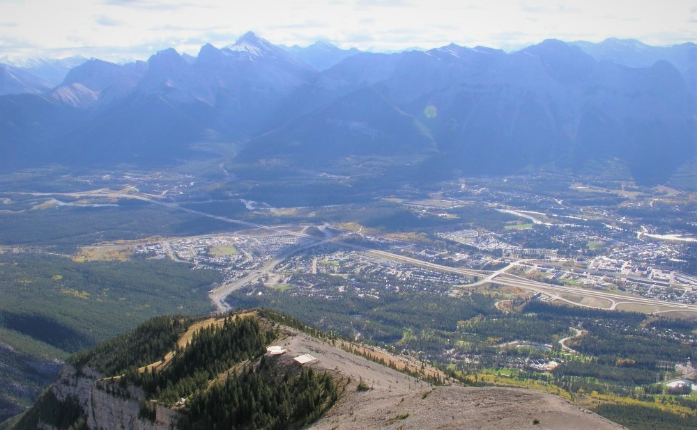 View of Canmore on the way down Lady MacDonald's summit, towards the proper hiking trail