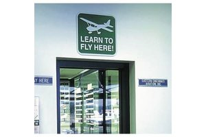 Sporty's Pilot Shop Learn to Fly Here Sign