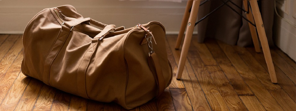 non leather duffle bag.png