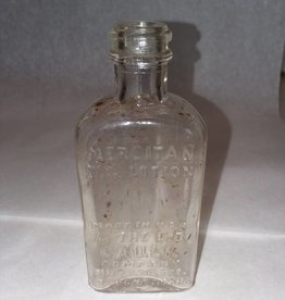 "Mercitan Lotion Bottle, Triangle Shape, 4.25"", E.1900's"