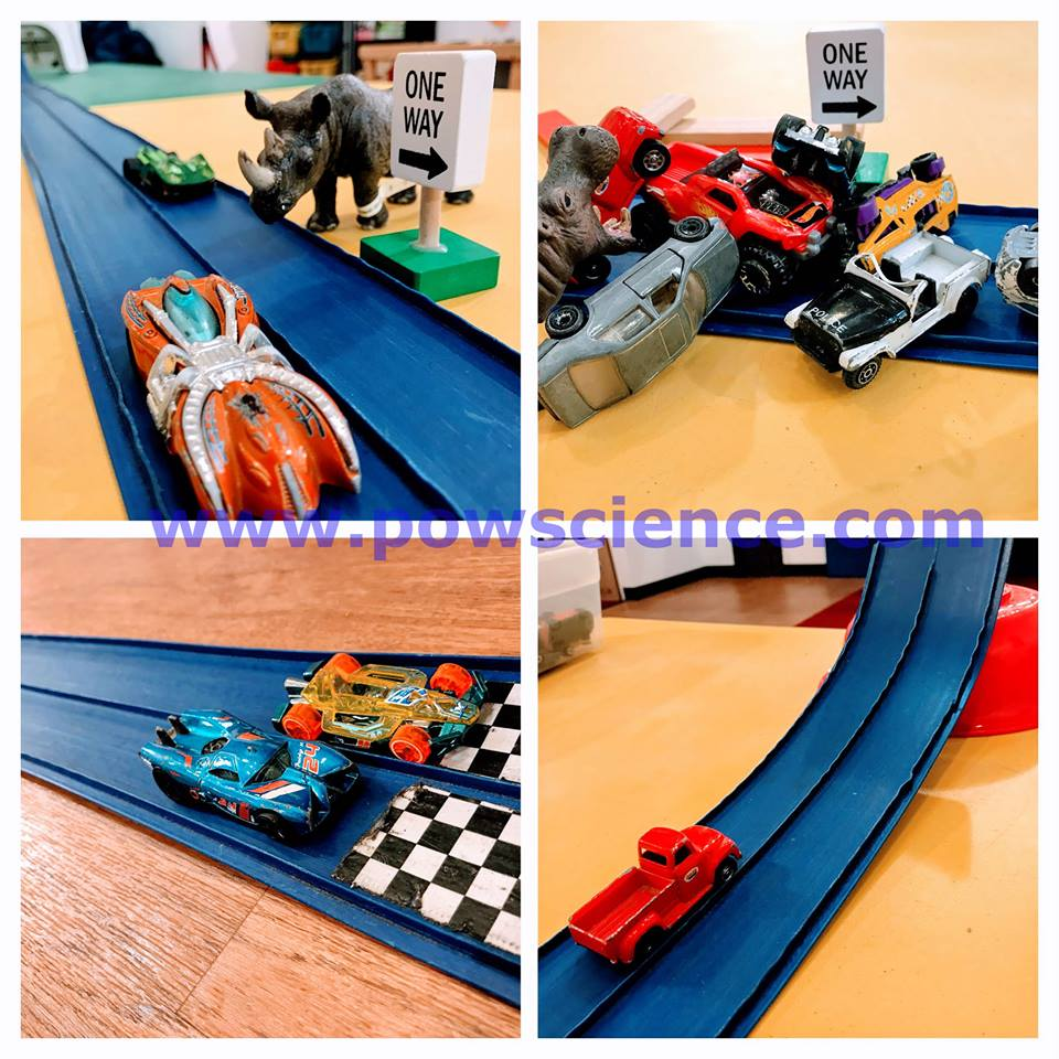 Hot Wheels cars and track.