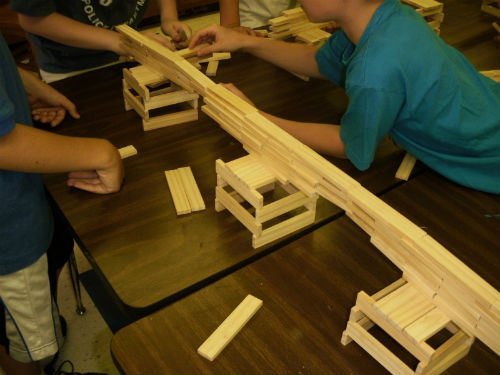 School children building a bridge with blocks