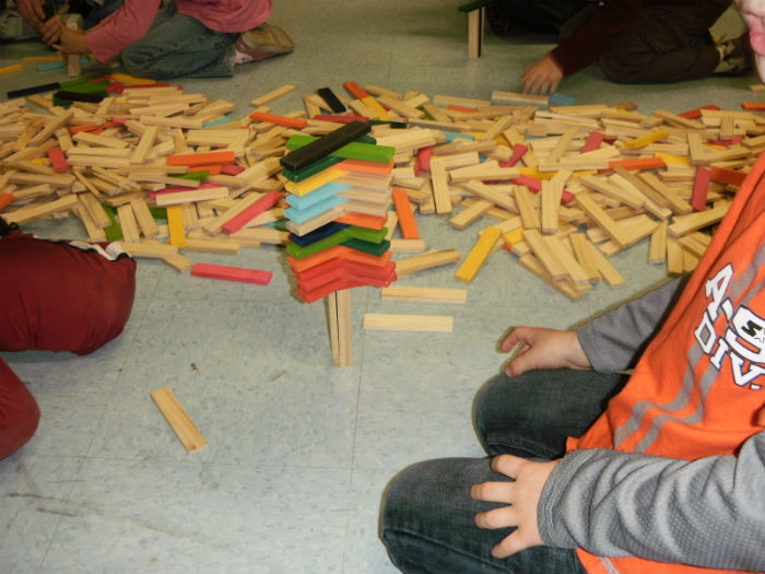 School children building with blocks