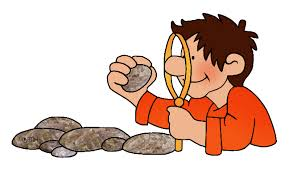 Student studying rock with magnifying glass