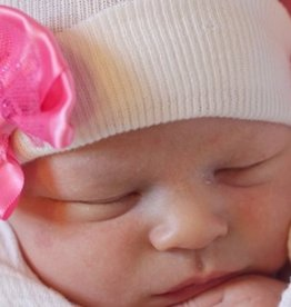 white newborn hat with pink sparkle bow