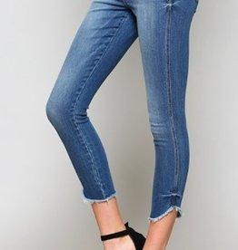 uneven raw hem skinny jeans