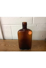 Old small whiskey bottle brown
