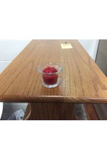 Red candle in small glass