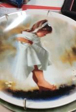 Decor plate girl in white dress