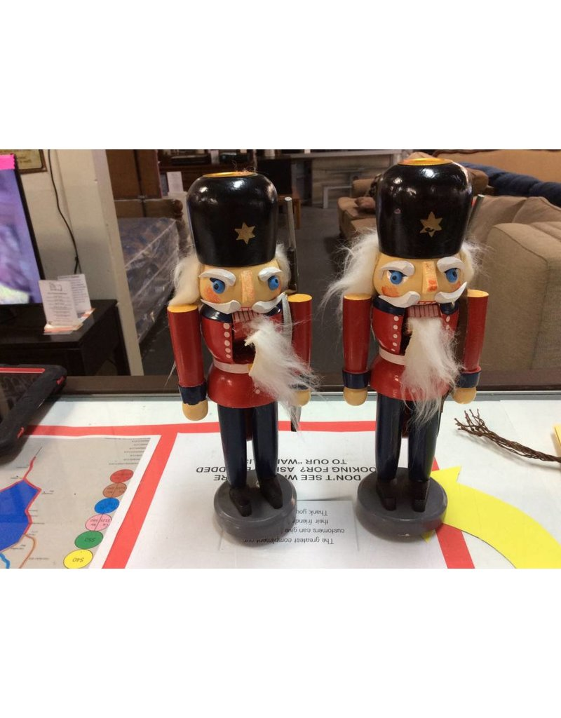 Pair nut cracker candle holders