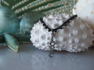 """MiNei Designs Necklace #1878: Black Onyx Beads with Sterling White Topaz """"LOVE"""" Charm"""