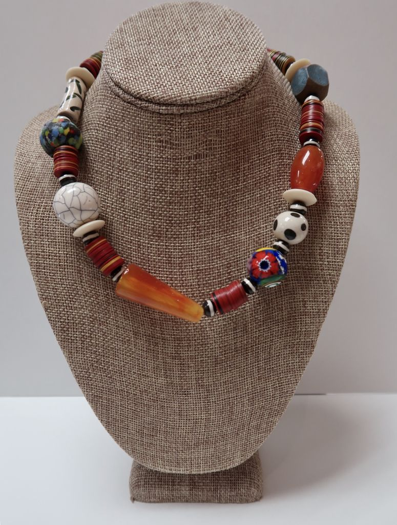 Beverly Creamer 18. BC-XM18 – A collection of Murano glass, African trade beads, handmade ceramic beads, interspersed with old vinyl records cut into discs in Kenya.