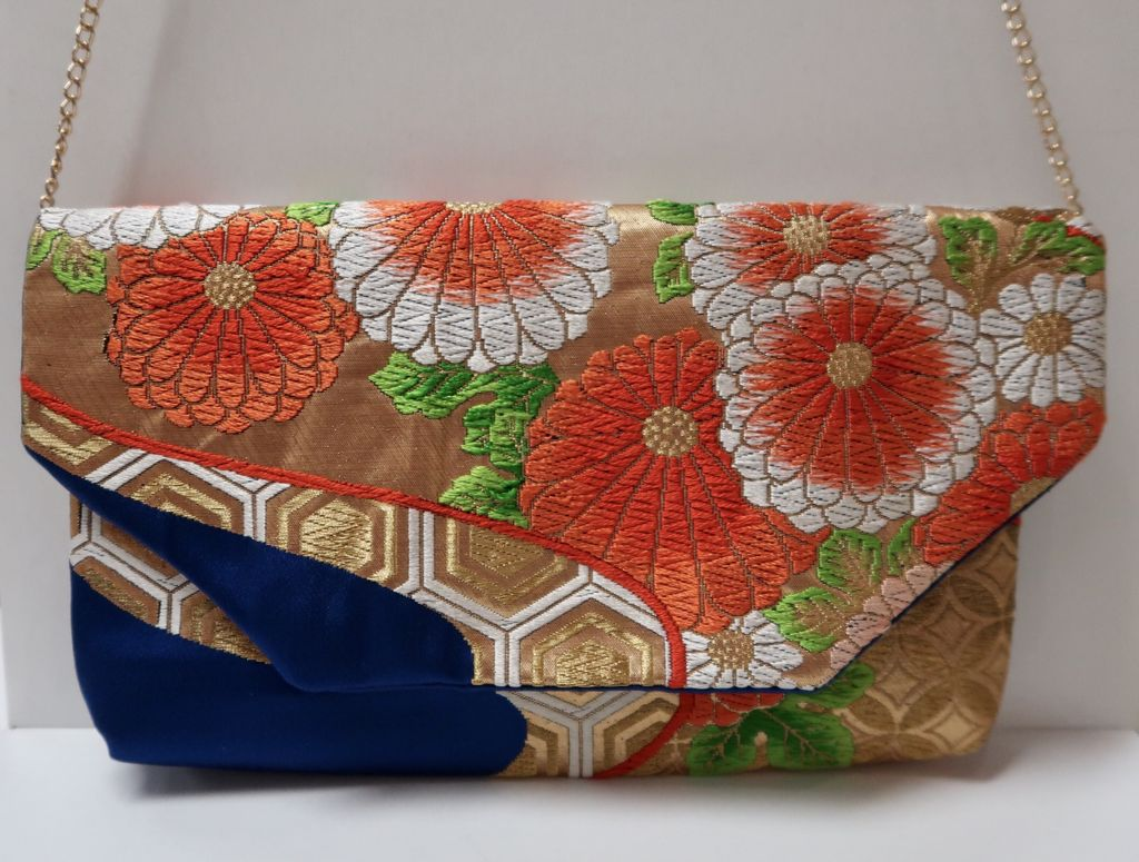 Leina Aonuma ROYAL BLUE/ORANGE/GOLD FLOWERS: OBI CLUTCH
