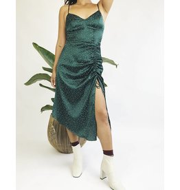 Green satin dress with white dots
