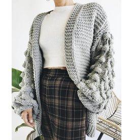Cardigan en tricot surdimensionné avec manches texturées à boucles