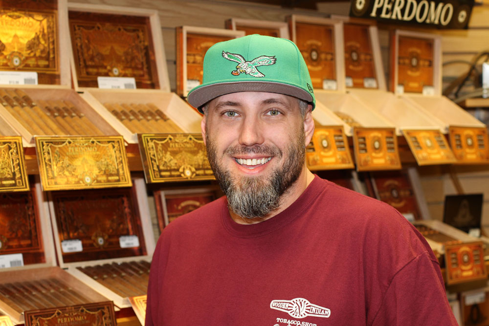 Dan Wood, lover of premium cigars and General Manager at Wooden Indian Tobacco Shop