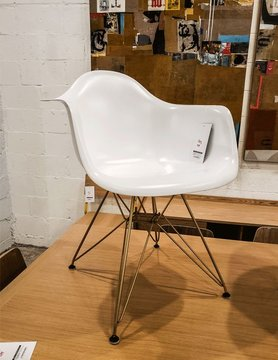 AEON MODERN CLASSIC Sasha White Matte Arm Chair with Champagne Finished Steel Eiffel Base